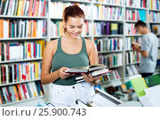 Купить «Girl holding open book in hands», фото № 25900743, снято 16 сентября 2016 г. (c) Яков Филимонов / Фотобанк Лори