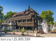 Купить «Shwenandaw Kyaung Temple or Golden Palace Monastery in Mandalay, Myanmar», фото № 25905599, снято 29 мая 2020 г. (c) BE&W Photo / Фотобанк Лори