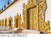 Купить «Atumashi Kyaung Monastery Maha Atulawaiyan Kyaungdawgyi is a Buddhist monastery located near Shwenandaw Monastery in Mandalay, Mianma», фото № 25905611, снято 17 октября 2018 г. (c) BE&W Photo / Фотобанк Лори