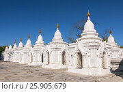 Купить «Kuthodaw Pagoda contains the worlds biggest book. There are 729 white stupas with caves with a marble slab inside - page with buddhist inscription. Mandalay, Myanmar», фото № 25905679, снято 16 февраля 2020 г. (c) BE&W Photo / Фотобанк Лори