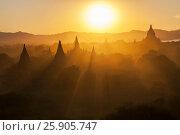 Купить «Sunset over the Temples of Bagan, Mandalay, Myanmar», фото № 25905747, снято 20 мая 2019 г. (c) BE&W Photo / Фотобанк Лори