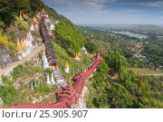 Купить «Path to the Pindaya caves, Buddhist shrine where thousands of Buddha images have been consecrated for worship over the centuries», фото № 25905907, снято 25 сентября 2018 г. (c) BE&W Photo / Фотобанк Лори