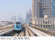 Купить «Metro railway and fully automated train in modern and luxury Dubai city, United Arab Emirates», фото № 25905963, снято 23 января 2018 г. (c) Joanna Malesa / Фотобанк Лори