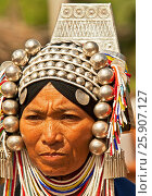 Akha hill tribe woman with traditional headdress, Chiang Mai Province, Thailand. Редакционное фото, агентство BE&W Photo / Фотобанк Лори