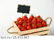 Купить «Red tomatoes with price sign over white», фото № 25913967, снято 15 мая 2016 г. (c) Anton Eine / Фотобанк Лори