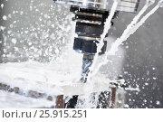 Купить «Milling metalworking process. Industrial CNC metal machining by vertical mill», фото № 25915251, снято 6 апреля 2017 г. (c) Дмитрий Калиновский / Фотобанк Лори