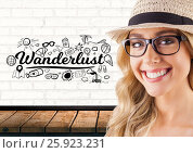 Happy woman in hat and Wanderlust holiday text with drawings graphics. Стоковое фото, агентство Wavebreak Media / Фотобанк Лори