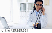 Купить «doctor with papers calling on phone at hospital», видеоролик № 25925351, снято 16 марта 2017 г. (c) Syda Productions / Фотобанк Лори