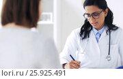 Купить «doctor with clipboard and woman at hospital», видеоролик № 25925491, снято 16 марта 2017 г. (c) Syda Productions / Фотобанк Лори