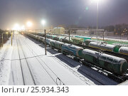 Купить «Freight cars on the sorting cargo station in the light of searchlights», фото № 25934343, снято 17 октября 2018 г. (c) Mikhail Starodubov / Фотобанк Лори