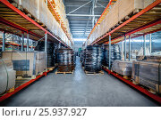 Купить «Long shelves with a variety of boxes and containers», фото № 25937927, снято 13 декабря 2016 г. (c) Андрей Радченко / Фотобанк Лори