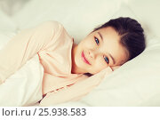 Купить «happy smiling girl lying awake in bed at home», фото № 25938583, снято 6 декабря 2015 г. (c) Syda Productions / Фотобанк Лори