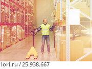 Купить «man with loader and clipboard at warehouse», фото № 25938667, снято 9 декабря 2015 г. (c) Syda Productions / Фотобанк Лори