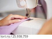 Купить «sewing machine presser foot stitching fabric», фото № 25938759, снято 29 сентября 2016 г. (c) Syda Productions / Фотобанк Лори