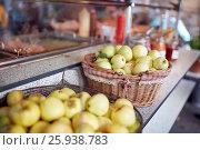 Купить «apples in baskets at street market», фото № 25938783, снято 3 октября 2016 г. (c) Syda Productions / Фотобанк Лори