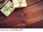 Купить «close up of handmade soap bars on wood», фото № 25938927, снято 21 декабря 2015 г. (c) Syda Productions / Фотобанк Лори