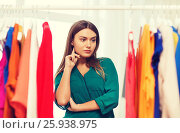 Купить «woman choosing clothes at home wardrobe», фото № 25938975, снято 19 февраля 2016 г. (c) Syda Productions / Фотобанк Лори