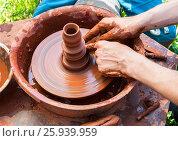 Купить «Керамические работы с глиной на гончарном круге. Крупный план», фото № 25939959, снято 19 августа 2018 г. (c) FotograFF / Фотобанк Лори