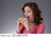 young beautiful girl disdainfully holding a junk food from fast food sandwich and do not want to eat. Стоковое фото, фотограф Анатолий Типляшин / Фотобанк Лори