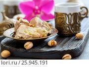 Купить «Tahini halva with pistachios on a bronze plate», фото № 25945191, снято 30 марта 2017 г. (c) Марина Сапрунова / Фотобанк Лори