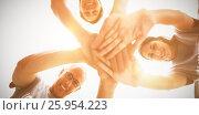 Happy volunteers stacking hands together. Стоковое фото, агентство Wavebreak Media / Фотобанк Лори