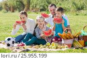 Купить «Family enjoying watermelon on picnic», фото № 25955199, снято 15 октября 2018 г. (c) Яков Филимонов / Фотобанк Лори