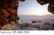 Купить «Зима. Пещера в скале покрытая льдом. Озеро Байкал», видеоролик № 25968059, снято 17 марта 2017 г. (c) Виталий Зверев / Фотобанк Лори