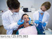 Купить «Dentists giving anesthesia to male patient», фото № 25975983, снято 11 декабря 2016 г. (c) Wavebreak Media / Фотобанк Лори