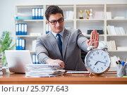 Купить «Young businessman in time management concept», фото № 25977643, снято 4 февраля 2017 г. (c) Elnur / Фотобанк Лори