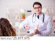 Купить «Traumatologist is taking care of the patient», фото № 25977975, снято 9 февраля 2017 г. (c) Elnur / Фотобанк Лори