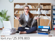 Купить «Busy angry businesswoman sitting on the desk in office», фото № 25978803, снято 13 января 2017 г. (c) Elnur / Фотобанк Лори