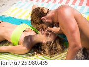 Купить «Young couple at beach on sunny day», фото № 25980435, снято 17 января 2017 г. (c) Wavebreak Media / Фотобанк Лори