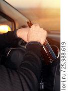 Купить «Young man driving under alcohol influence», фото № 25988619, снято 21 ноября 2016 г. (c) Pavel Biryukov / Фотобанк Лори