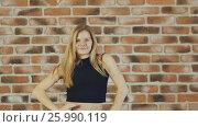 Купить «Hip hop blonde girl dancing in modern style over urban brick wall. Slow motion.», видеоролик № 25990119, снято 14 апреля 2017 г. (c) Mikhail Davidovich / Фотобанк Лори