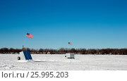 Купить «Ice Shanties on Frozen Lake with American Flags», фото № 25995203, снято 19 сентября 2018 г. (c) easy Fotostock / Фотобанк Лори