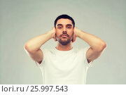 Купить «latin man covering his ears with hand palms», фото № 25997543, снято 15 января 2016 г. (c) Syda Productions / Фотобанк Лори