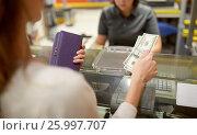 Купить «woman paying money at store cash register», фото № 25997707, снято 21 октября 2016 г. (c) Syda Productions / Фотобанк Лори