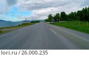 Купить «Driving a Car on a Road in Norway», видеоролик № 26000235, снято 16 марта 2017 г. (c) Андрей Армягов / Фотобанк Лори