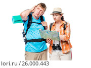 Lost stray couple of tourists with backpacks with a card pondering, posing against white background. Стоковое фото, фотограф Константин Лабунский / Фотобанк Лори