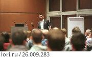 Купить «Public speaker giving talk at business event», видеоролик № 26009283, снято 5 апреля 2020 г. (c) Matej Kastelic / Фотобанк Лори