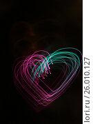 Купить «Background with heart-shaped lights», фото № 26010127, снято 25 ноября 2011 г. (c) Tatjana Romanova / Фотобанк Лори