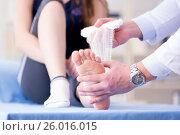 Купить «Traumatologist is taking care of the patient», фото № 26016015, снято 9 февраля 2017 г. (c) Elnur / Фотобанк Лори