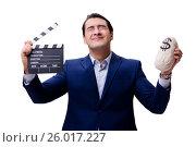 Купить «Handsome man with movie clapper isolated on white», фото № 26017227, снято 5 ноября 2016 г. (c) Elnur / Фотобанк Лори