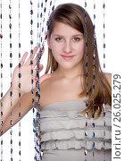 Купить «A girl peeks out from the curtain», фото № 26025279, снято 27 января 2012 г. (c) Tatjana Romanova / Фотобанк Лори