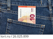 Banknote 10 euro sticking out of the back jeans pocket. Money for travel and shopping, фото № 26025899, снято 21 апреля 2017 г. (c) FotograFF / Фотобанк Лори