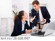 Купить «Sad subordinate woman being accused to making mistake by man colleague», фото № 26026047, снято 16 июня 2019 г. (c) Яков Филимонов / Фотобанк Лори