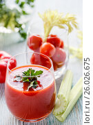Tomato juice in a glass with parsley, cherry tomatoes in a glass with celery on a wooden table. Стоковое фото, фотограф Ольга Соловьева / Фотобанк Лори