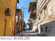 Купить «Street of Old city in Tbilisi, Georgia», фото № 26035259, снято 27 сентября 2016 г. (c) Elena Odareeva / Фотобанк Лори