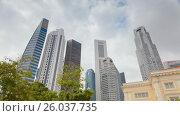 Купить «Timelapse View On Singapore downtown City Skyscrapers», видеоролик № 26037735, снято 23 марта 2019 г. (c) Кирилл Трифонов / Фотобанк Лори