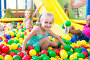 portrait of girl playing in pool with plastic multicolored balls, фото № 26046911, снято 22 апреля 2017 г. (c) Яков Филимонов / Фотобанк Лори